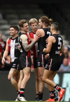 thumbnail_The Master and his apprentices. Riewoldt congratulated by Tim Membrey and Josh Bruce